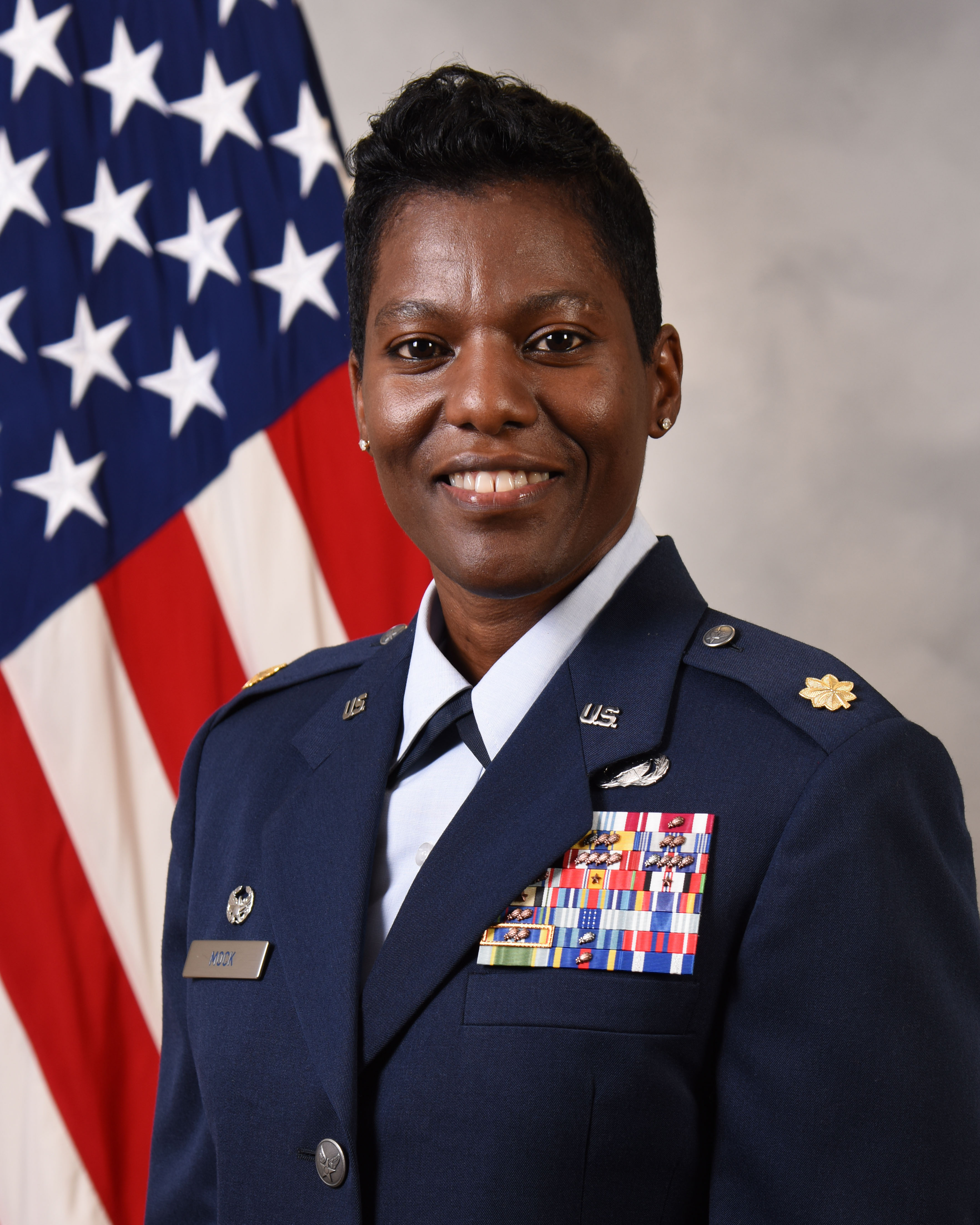 Maj. Karen Mock official photo with American flag background