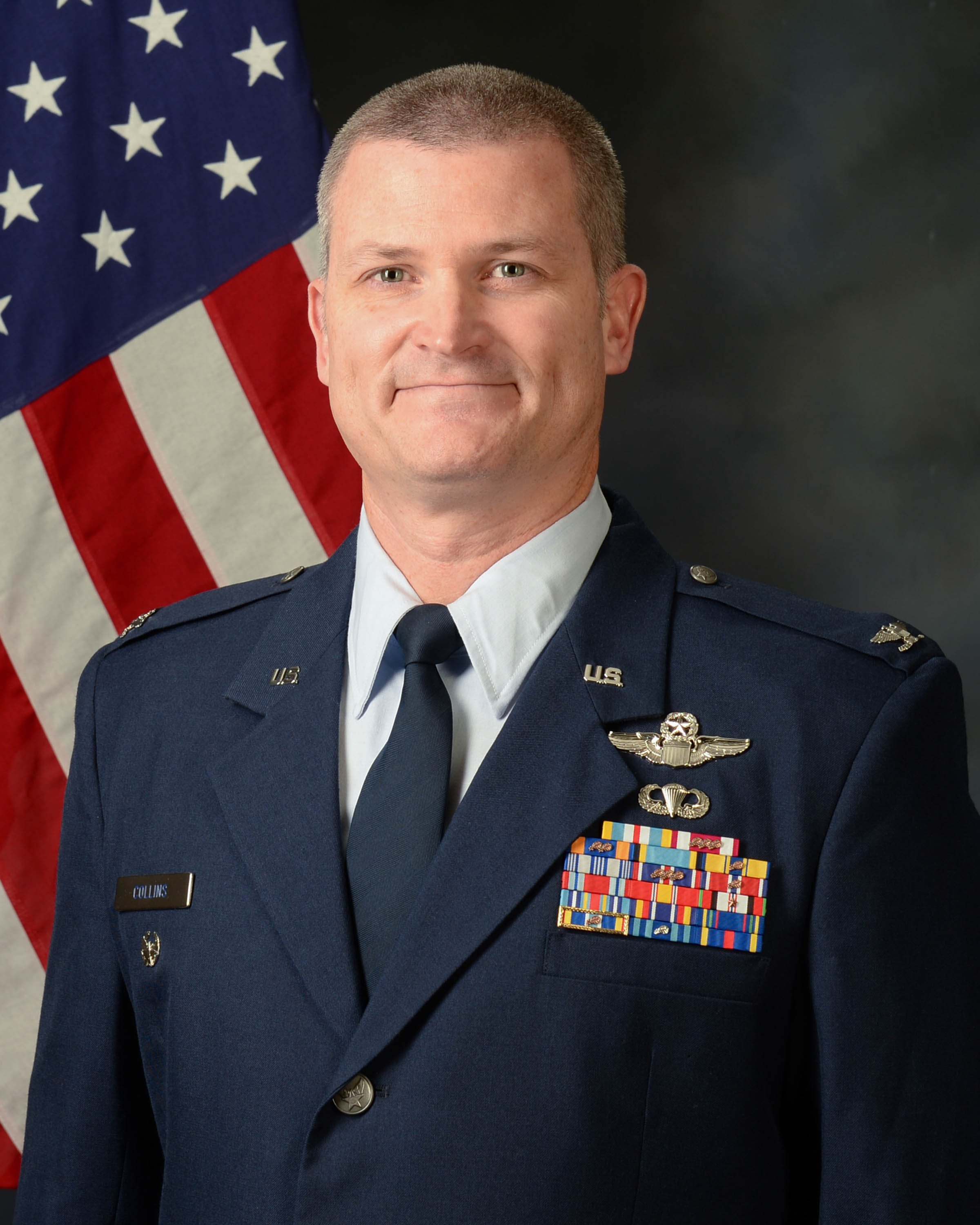 Colonel Brian Collins official photo with American flag background