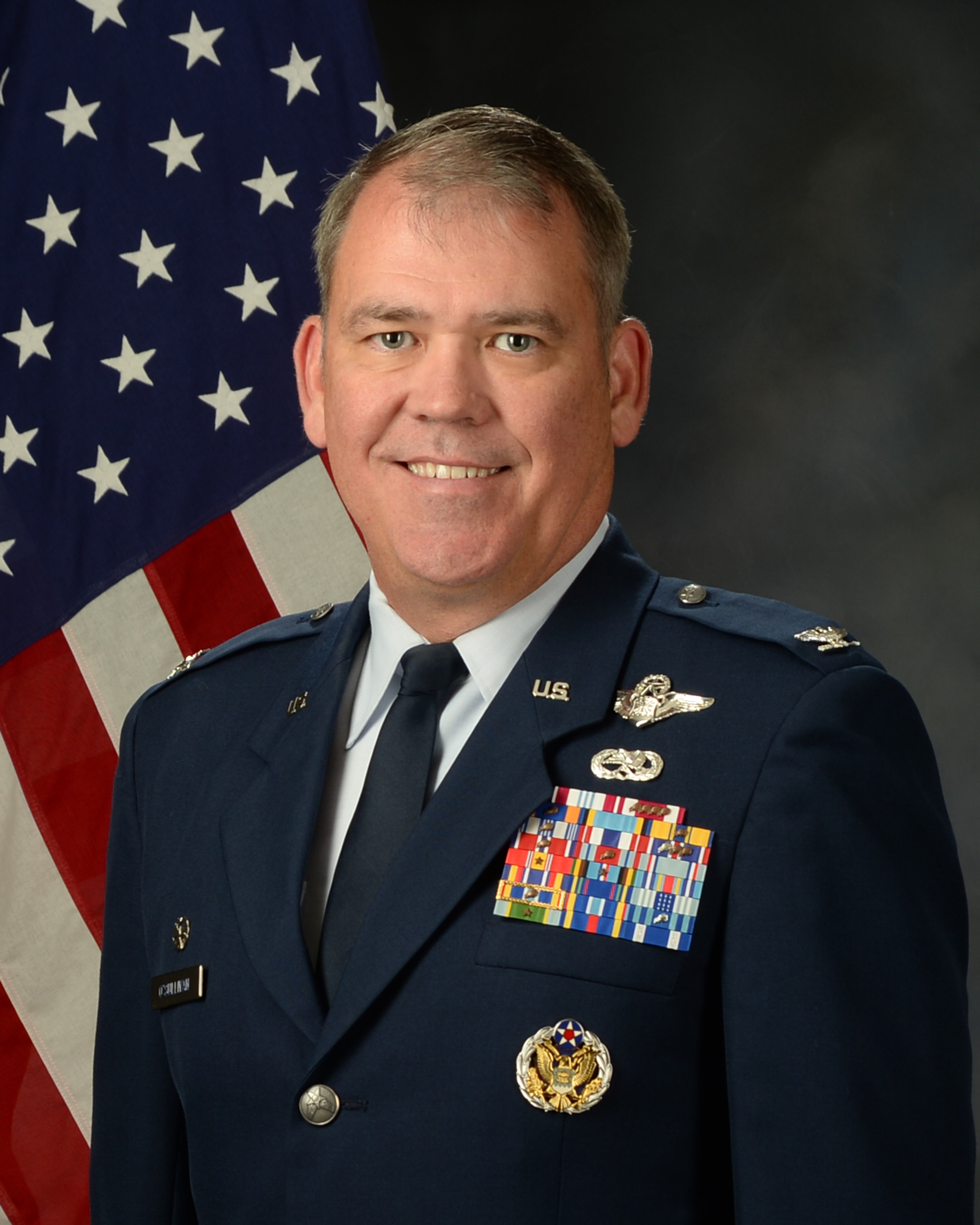 Colonel Patrick O'Sullivan official photo with American flag background